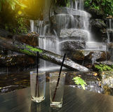 Defocused or blurred photo of waterfall montage with wood table Royalty Free Stock Image