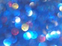 Defocused bokeh光,蓝色,红色和黄色模糊的闪闪发光,背景 库存照片