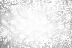 Defocused Bokeh光,闪烁迷离斑点在银a点燃 免版税图库摄影