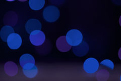 Defocused Bokeh Background of Blue Fairy Light String. Blurred or out of focus blue and purple coloured fairy lights to form a bokeh background with space for stock photos