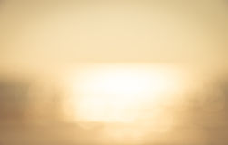 Defocused bokeh image of sun near the sea abstract background Stock Photos