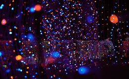 Defocused bokeh of LED lights in new year night royalty free stock images