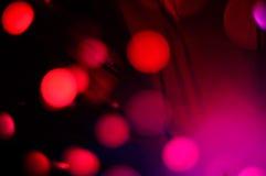 Defocused Bokeh-Lichter auf dem schwarzen Hintergrund Stockfoto