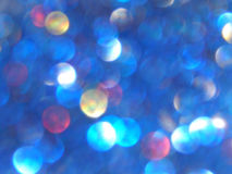 Defocused bokeh light, blue, red and yellow blurry sparkles, background Stock Photo