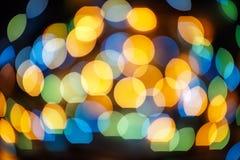 Defocused bokeh lights effect in night. City Royalty Free Stock Photo