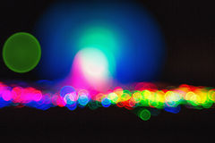 Defocused bokeh lights: optic fiber close-up. Hi-tech concept - defocused illumination from fiber optic glass Royalty Free Stock Image