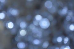 Defocused bokeh som blinkar ljusbakgrund Arkivbilder