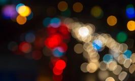 Defocused bokeh traffic light in city at night Stock Photos