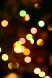 Defocused bokeh twinkling lights background Stock Images