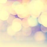 Defocused Bokeh twinkling lights Vintage background. Festive bac Stock Image