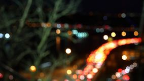 Defocused bright bokeh timelapse of traffic jam on an overpass at night. 