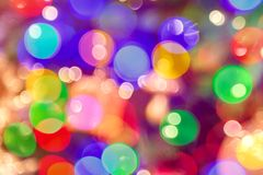 Defocused bright colorful bokeh background. Holiday texture pattern stock images