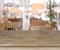 Defocused cafe interior background with wooden table in front Royalty Free Stock Photography