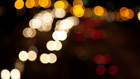Defocused car lights moving at night time Royalty Free Stock Photo