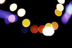 Defocused carlights over dark background. Urban Royalty Free Stock Photos