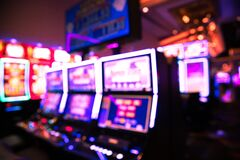 Free Defocused Casino Blur With Slot Machines And Lights Stock Image - 182354091