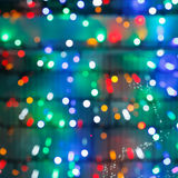 Defocused christmas illumination in dark night Stock Image