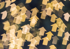 Defocused of Christmas lights in arrow shape Royalty Free Stock Images
