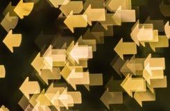 Defocused of Christmas lights in arrow shape background Stock Photos
