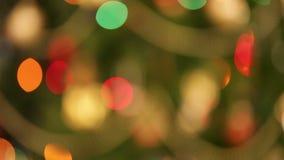 Defocused christmas lights background. Defocused blinking christmas lights background stock footage