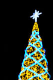Defocused christmas lights background. At night Royalty Free Stock Image