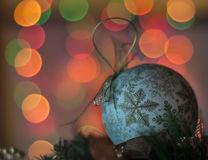 Defocused Christmas lights. Christmas ball as decoration on abstract background. Shallow depth of field Royalty Free Stock Image