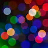 Defocused Christmas lights, blur background. Royalty Free Stock Photo