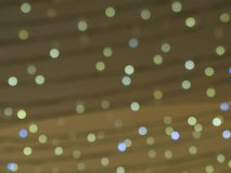 Defocused christmas lights golden and blue bokeh lights circles Stock Images