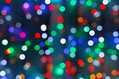 Defocused christmas lights in dark night. In city Royalty Free Stock Photography