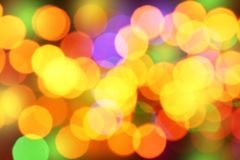 Defocused Christmas lights. As background Royalty Free Stock Photo