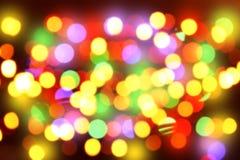Defocused Christmas lights. As background Stock Photos