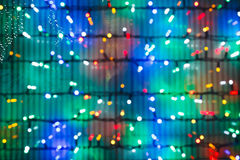 Defocused christmas lights on window. In night royalty free stock photos
