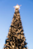 Defocused christmas tree with blurred lights Royalty Free Stock Images