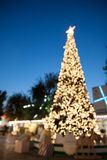 Defocused christmas tree with bokeh light Stock Photos