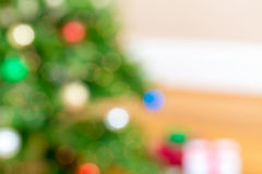 Defocused Christmas tree and gifts abstract background Stock Photography