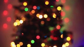 Defocused christmas tree lights with Colorful bokeh. Beautiful abstract background. 1920x1080 stock footage