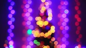 Defocused christmas tree lights with Colorful bokeh. 1920x1080 stock footage