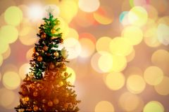Composite image of defocused of christmas tree lights and fireplace. Defocused of Christmas tree lights and fireplace against christmas tree with ornaments stock photo