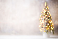 Defocused christmas tree silhouette with blurred lights. Royalty Free Stock Images