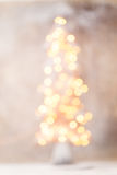 Defocused christmas tree silhouette with blurred lights. Stock Photo