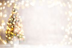 Defocused christmas tree silhouette with blurred lights. Royalty Free Stock Image