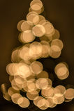 Defocused christmas tree with soft blur bokeh with lights and bubbles background Stock Photos