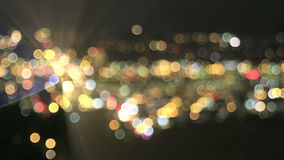 Defocused City Lights with Moving Car Beams Bokeh Background Royalty Free Stock Photos
