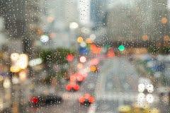 Defocused city view through rainy window Stock Photo