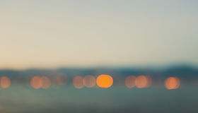 Defocused coastline after sunset Stock Image