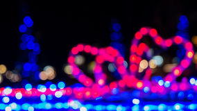 Defocused colorful bokeh light from bow gift box – Christmas night in city Stock Image