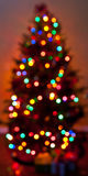 Defocused colorful Christmas tree lights Stock Photos