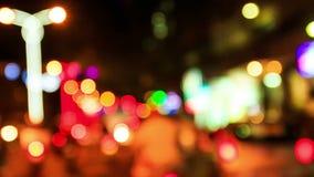 Defocused Colorful Night Street Illumination. Closeup camera approaches defocused colourful night street illumination stock video footage
