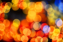 Defocused colourful bokeh twinkling lights background Stock Images