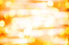 Defocused com fundo da luz amarela Fotografia de Stock Royalty Free